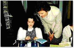 Emer Finnegan demonstrating Kenmare lace to the irish president during her visit..